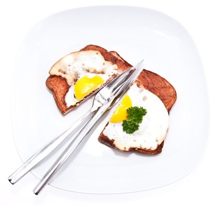 semmel: Halved meat loaf with fried egg on a plate isolated on white background