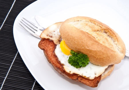 leberkaese: Roll with meat loaf and fried egg on a plate Stock Photo