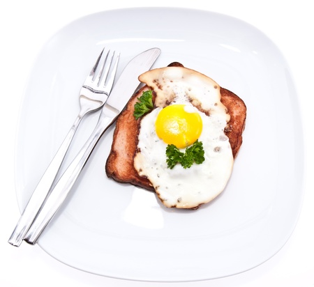 semmel: Meat loaf with fried egg on top isolated on white background