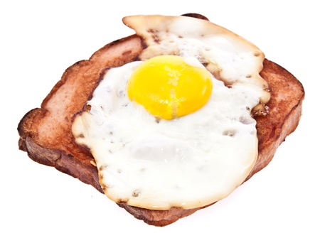Meat loaf with fried egg on top isolated on white background Stock Photo - 13778885