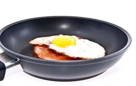 leberkaese: Meat loaf and fried egg in a skillet isolated on white background