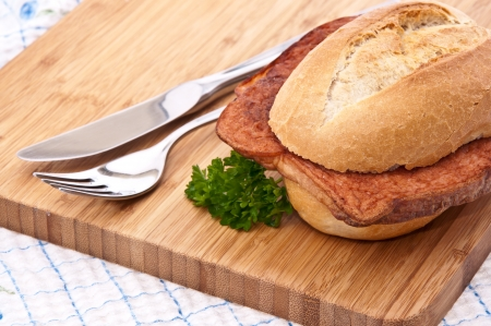 semmel: Meat loaf on a roll on cutting board Stock Photo
