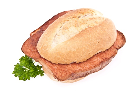 leberkaese: German meat loaf on a roll isolated on white background