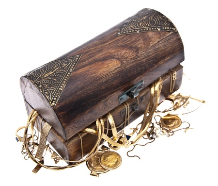 Treasure box with old jewelry isolated on white background photo
