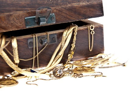 Treasure box with old jewelry isolated on white background (macro view) photo