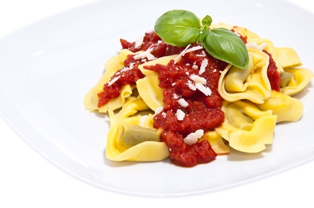 tortellini: Tortellini with tomato sauce and Parmesan Cheese on a plate