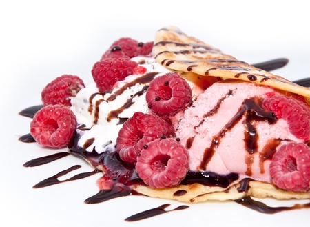 Fresh Raspberry ice cream in a Pan Cake decorated with Raspberries and chocolate syrup photo