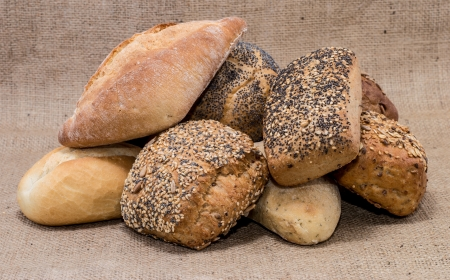 Heap of rolls on textile background photo