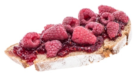 Bread with Raspberry Jam and fresh fruits isolated on white photo