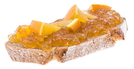 Slice of bread with Orange Jam isolated on white background photo