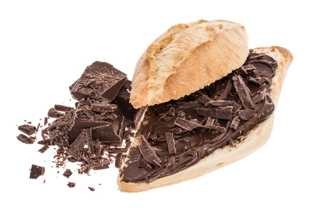 Bun with Chocolate Creme and Chocolate pieces isolated on white photo