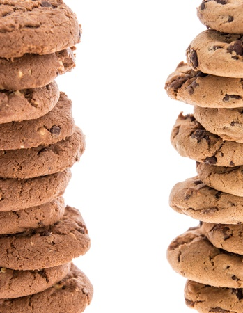 Two towers of stacked Cookies isolated on white photo