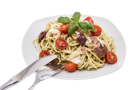 Spaghetti wit Pesto Sauce on white background photo