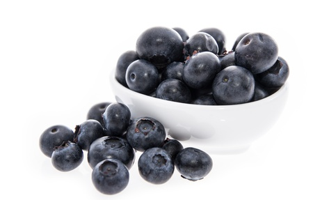 Blueberries in a bowl isolated on white background