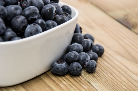 White bowl filled with fresh Blueberries Stock Photo - 14656261