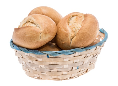 Small basket filled with buns isolated on white photo