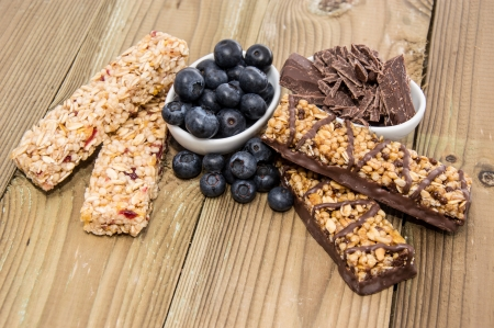 Muesli Bars with Blueberries and Chocolate on wooden background photo