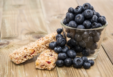 Muesli Bars with Blueberries in a glass on a wooden table photo