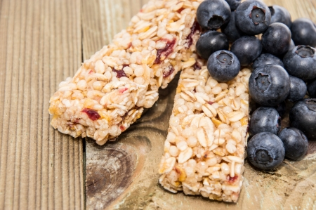 Muesli Bars with fresh Blueberries on wooden background photo