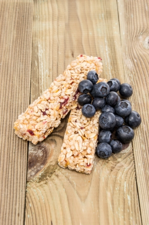 energy bar: Muesli Bars with fresh Blueberries on wooden background Stock Photo