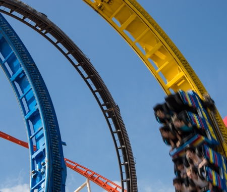 Rollercoaster in a looping against blue sky photo