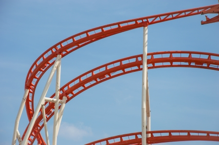 Rollercoaster rails against blue sky photo