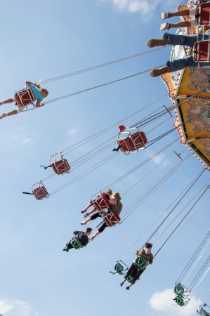 chairoplane: Chairoplane with people on ride and blue sky in the background