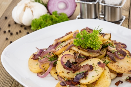 chippy: Portion of fried Potatoes with raw ingredients in the background