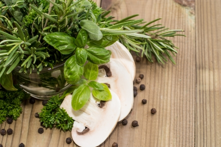 Fresh Mushrooms with Herbs on wooden background Stock Photo