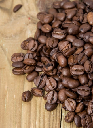 Old wooden Table with Coffee Beans photo