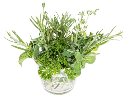 Different Herbs in a glass isolated on white background Stock Photo - 14773934