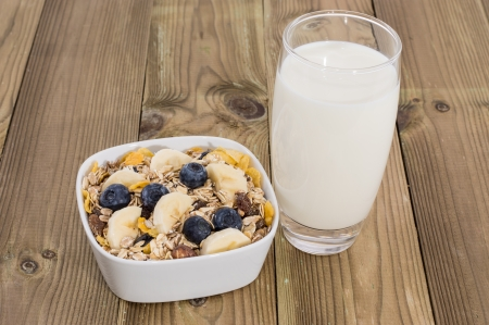Mixed Muesli with Nuts and Fruits on wooden background photo