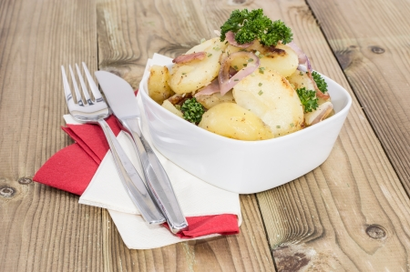 chippy: Bowl with fried Potatoes on wooden background