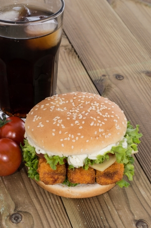 Fish Burger with ingredients on wooden background photo