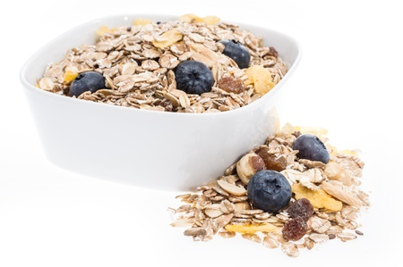 Mixed Muesli in a bowl isolated on white background photo