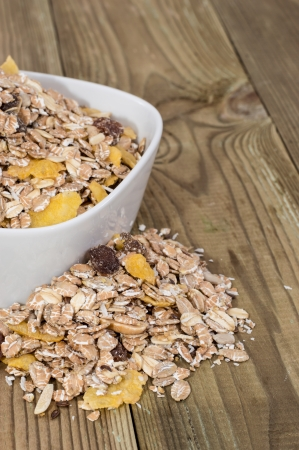 Bowl with mixed Muesli on wood photo