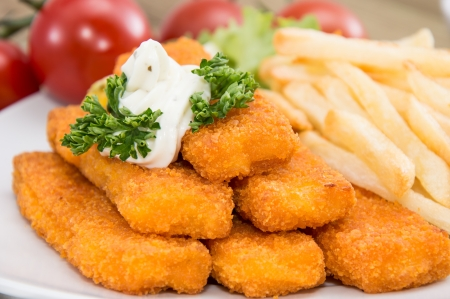 Fish Fingers with Remoulade and Chips on wooden background photo