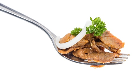 Kebab on a fork isolated on white