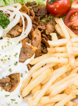 Portion of Kebab with Chips and Sauce (macro shot) photo