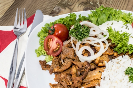 Plate with Kebab and Rice on wooden background photo