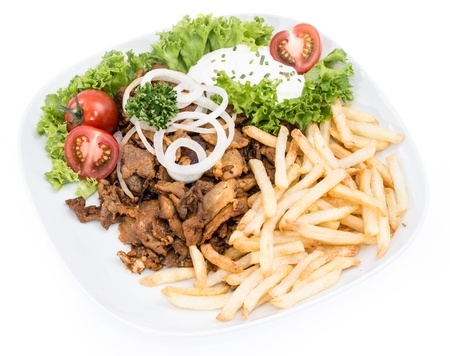 Plate with Kebab and Chips isolated on white background photo