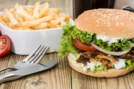 gyros: Kekab Burger with Chips in a bowl on wooden background