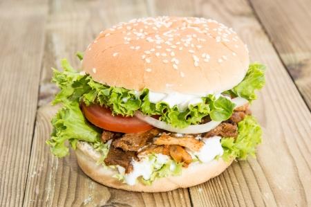 Homemade Kebab Burger on wooden background photo