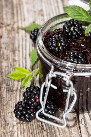 wildberry: Blackberry Jam with fresh fruits isolated on white Stock Photo