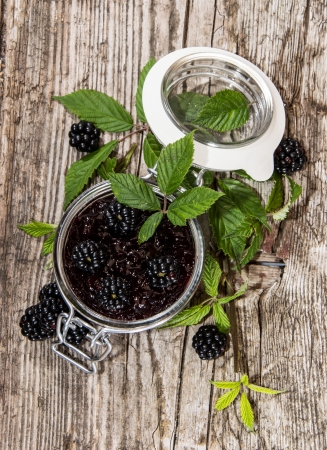 wildberry: Blackberry Jam in a glass on wooden background