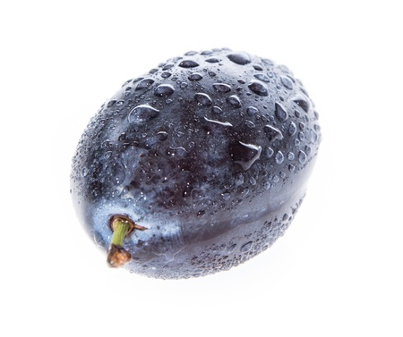 Plum with water drops isolated on white background photo