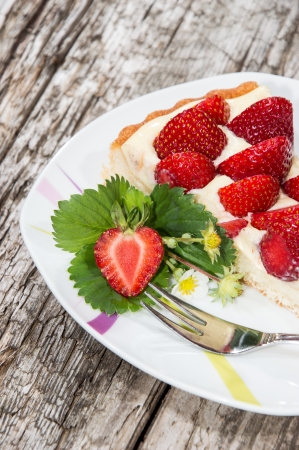Homemade Strawberry Cake on wooden background Stock Photo - 15019461