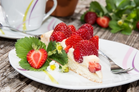 strawberry cake: Vintage Table with a piece of Cake