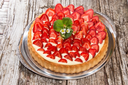 sweet tart: Fresh Cake on a silver Plate against wooden background Stock Photo