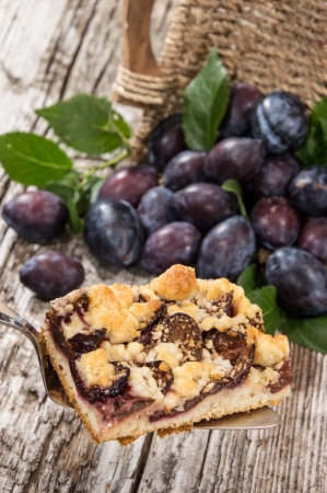 Plum Cake on a lifter with fresh fruits in the background Stock Photo - 15023626